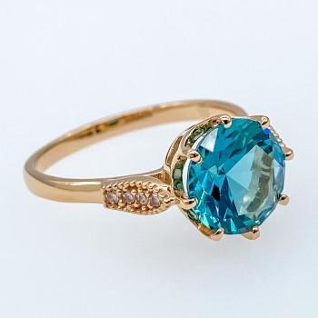 Ροζ χρυσό δαχτυλίδι με πετρόλ πέτρα